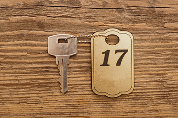 Close up shot of hotel room key shot on wooden background