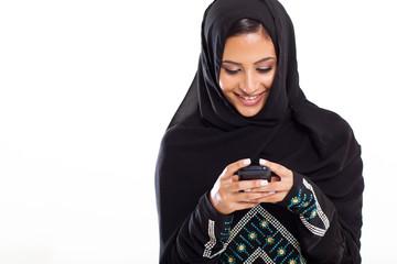 modern Arabic woman playing on smart phone