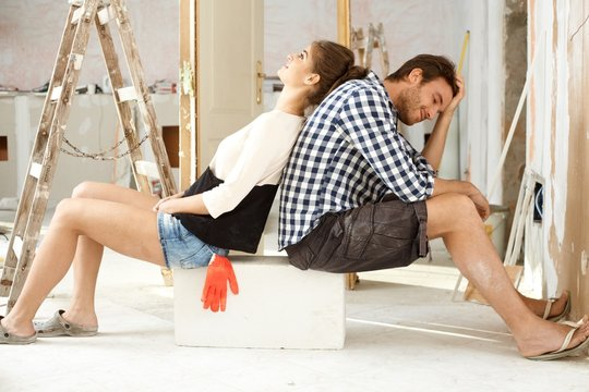 Exhausted DIY couple