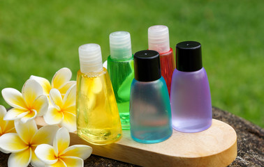 Wall Mural - Toiletries with plumeria flowers for spa concept