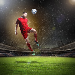 Deurstickers voetbal football player striking the ball