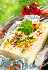 Halloumi cheese grilling in tin foil