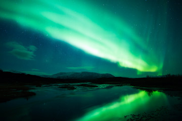 Wall Mural - Northern lights above lagoon in Iceland