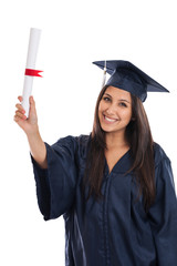 Mixed race college graduate woman in cap and gown