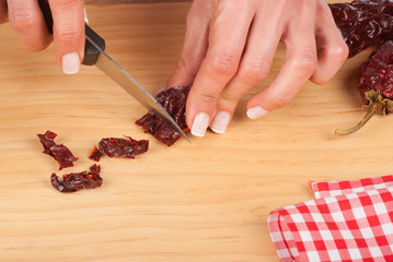 Chopping dried peppers