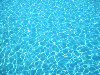 Clear blue water in swimming pool