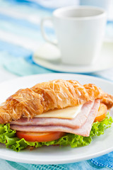 croissant ham cheese with coffee