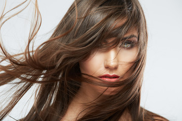 Woman face with hair motion on white background isolated