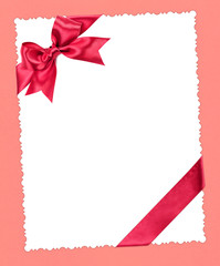 blank paper sheet with red bow on pink