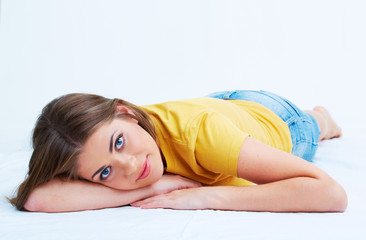 Portrait of smiling young woman lying on floor