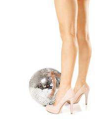 Woman legs and disco ball