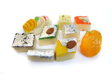 Various Indian sweets on white background