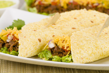Shredded beef taco with salsa, sour cream and cheese