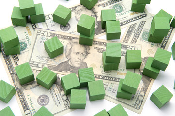 Concept photo invest green building blocks twenty dollar bills