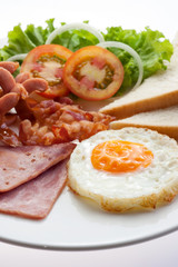 American Breakfast ham bacon egg bread and sausage