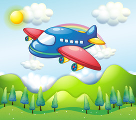 A colorful airplane above the hills