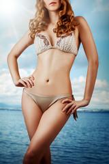 sexy slim woman in beige bikini