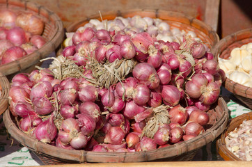 Red onions in bamboo basket