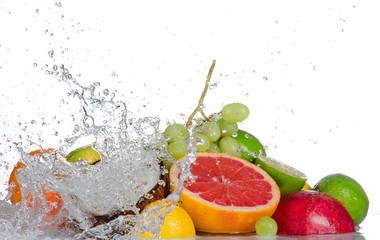 Fototapeta Fresh fruits with water splash isolated on white