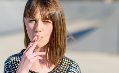 Portrait Of Young Woman Smoking