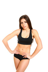 Portrait of fitness girl on a white background
