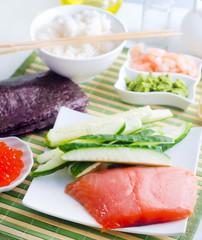 ingredients for sushi, sakmon and cucumber