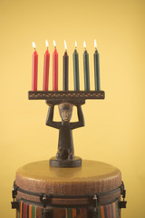 Candles with candlestick on drum
