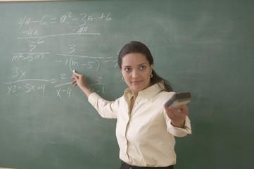 Female teacher at chalkboard