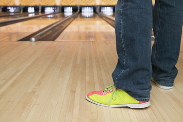 Low section of feet at bowling alley