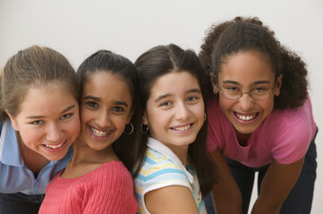 Portrait of four girls smiling