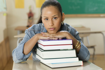 Female Dominican teenager at her desk in classroom