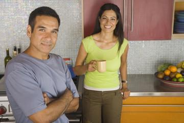Portrait of Hispanic couple in kitchen