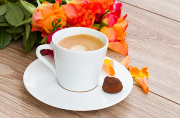 cup of coffee with orange roses
