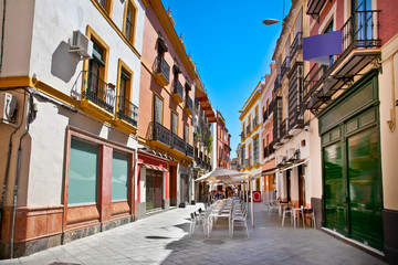Wall Mural - Street in old part of Seville town on summer day, Spain.