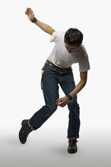 Asian man in rockabilly clothing dancing