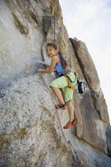 Asian girl rock climbing