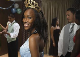 African teenaged girl wearing tiara at prom
