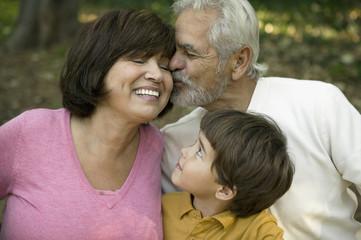 Hispanic boy smiling at grandparents