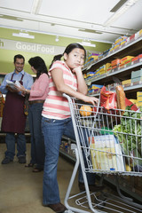Asian mother and daughter grocery shopping