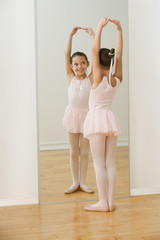 Hispanic girl practicing ballet