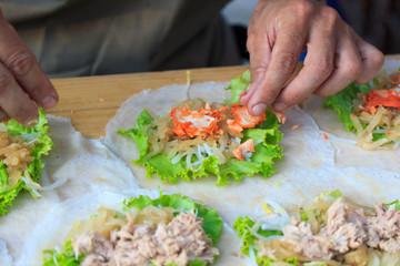 Man making spring rolls