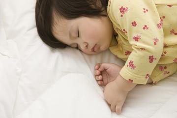 Mixed race girl sleeping
