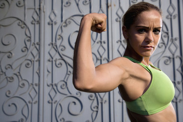 Hispanic woman flexing biceps