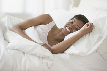 African woman laying in bed
