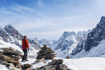 Skier looking out over mountain landscape in Chamonix, France