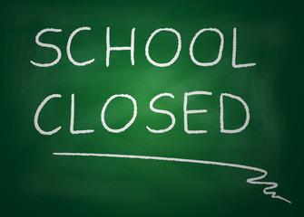 Blackboard on which is written with chalk school closed