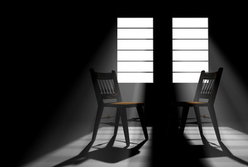 Darkened room with two windows with sunlight streaming in