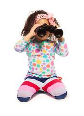 Portrait of super cute black girl with binoculars
