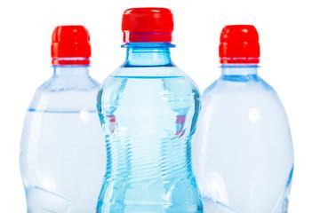 three tops of bottles of water