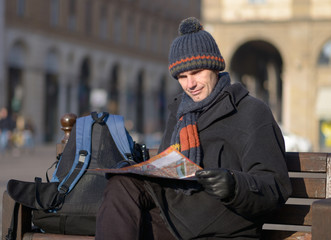 Tourist with city plan